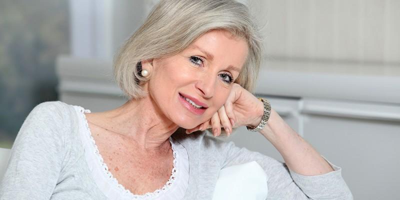 Closeup of smiling senior woman relaxing at home